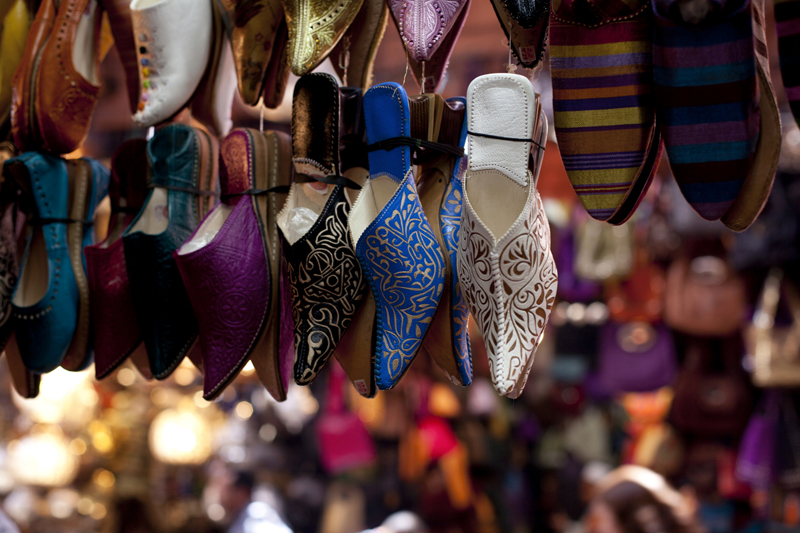 Ornamented traditional moroccan shoes in medina street souk